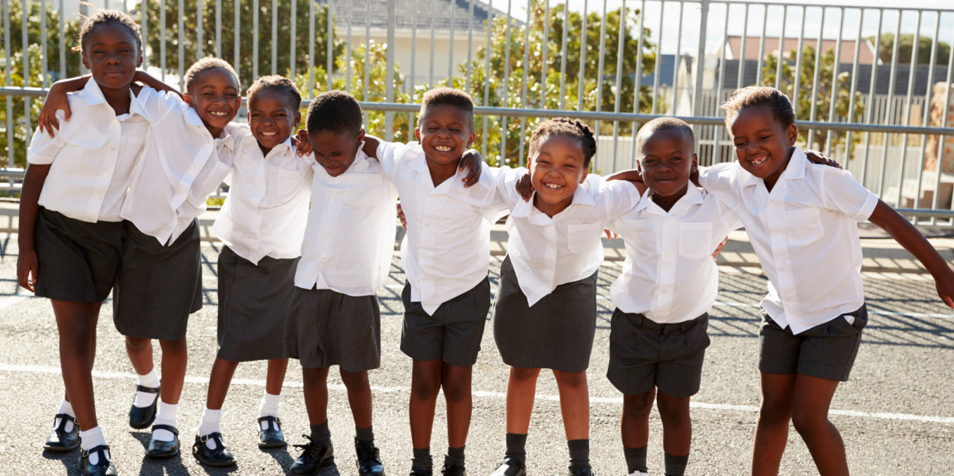a group of african pupils looking at camera while smiling